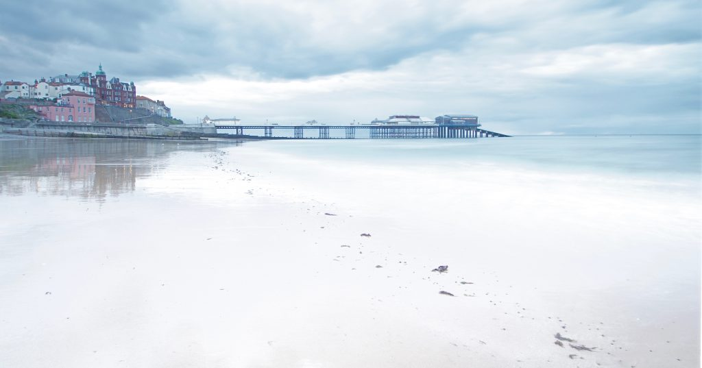 This image has an empty alt attribute; its file name is Footsteps-Cromer-Pier-by-Richard-1-1024x537.jpeg
