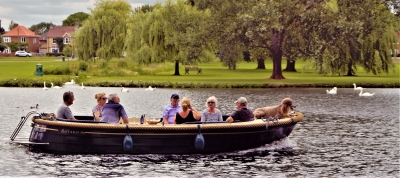 seven-people-dog-in-a-boat-by-paul-waite